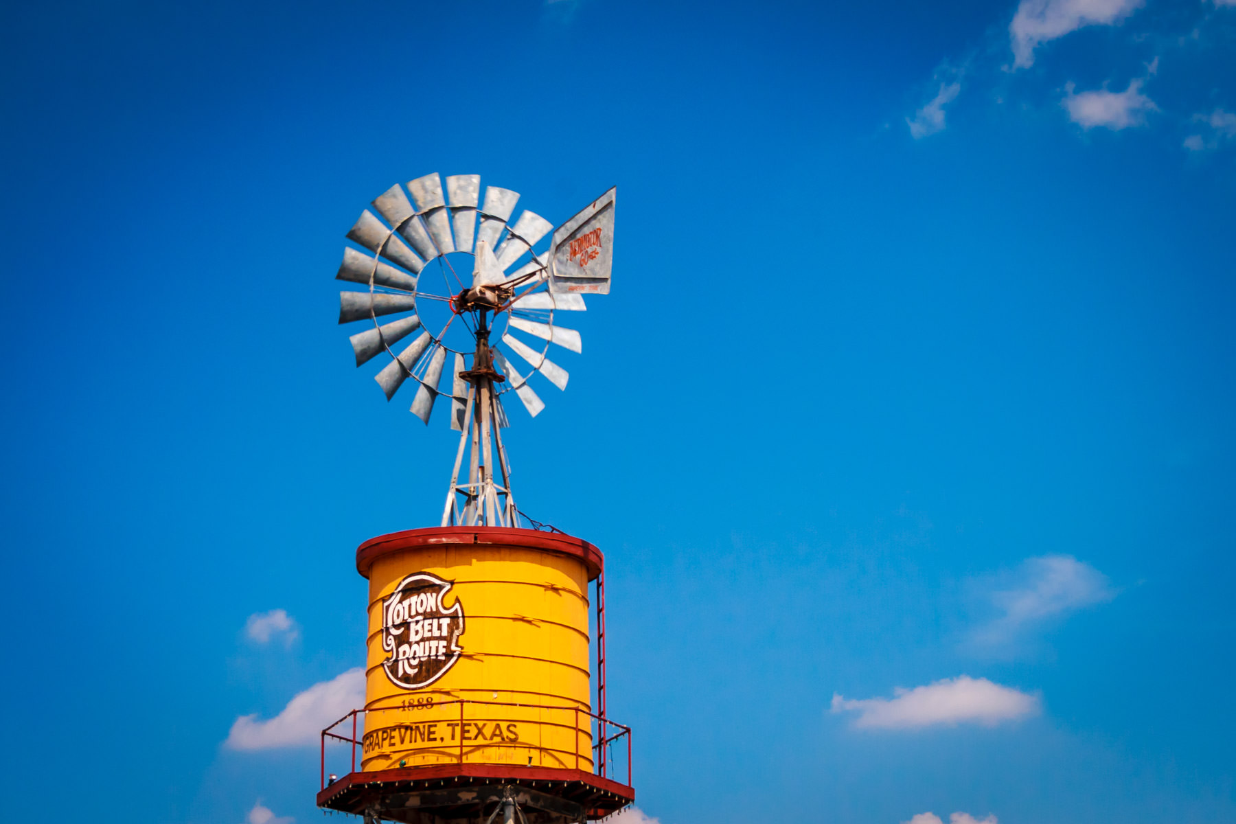 A vintage Cotton Belt Route Aeromotor-brand windmill atop a water tower in Grapevine, Texas.