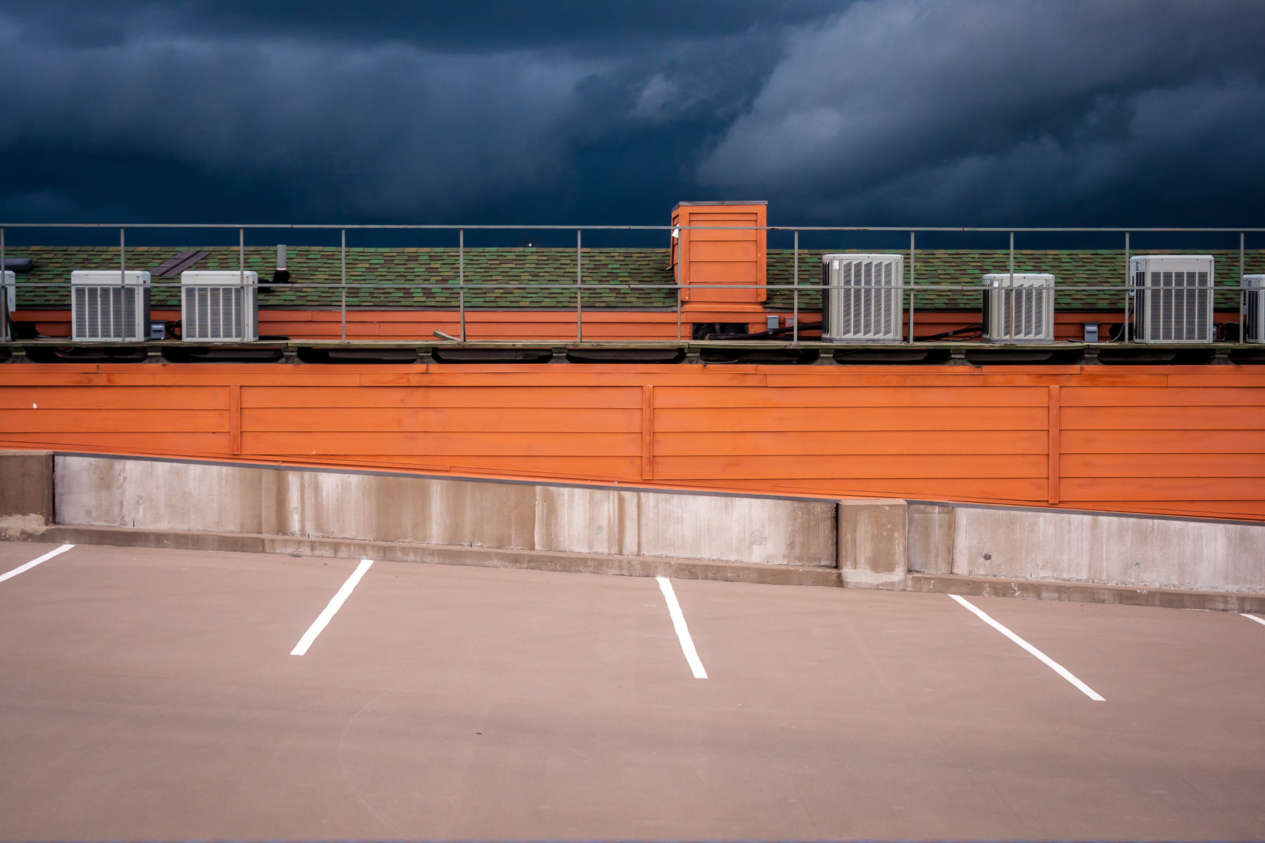 Storm clouds rolling into Collin County, as seen from the Eastside Village parking garage in Downtown Plano, Texas.