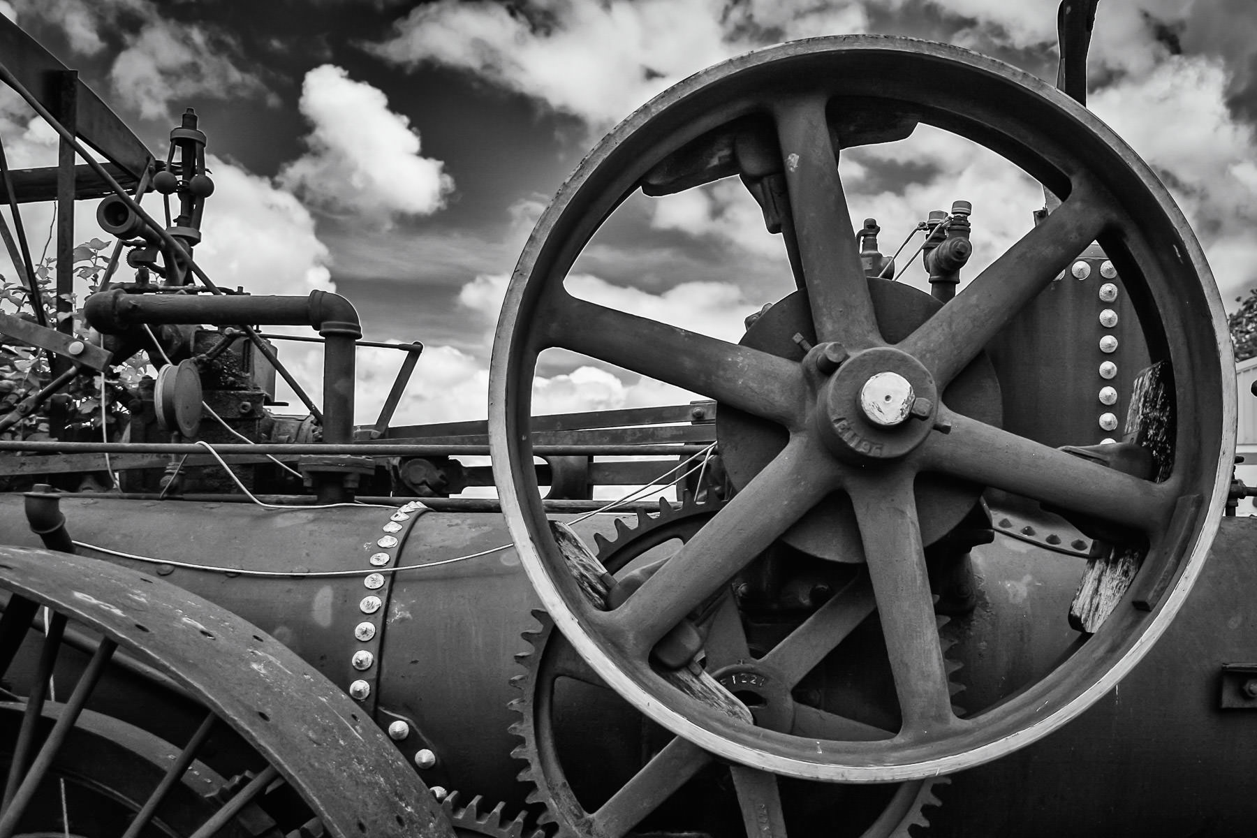 Detail of the engine of an ancient steam-powered tractor in Marietta, Oklahoma.