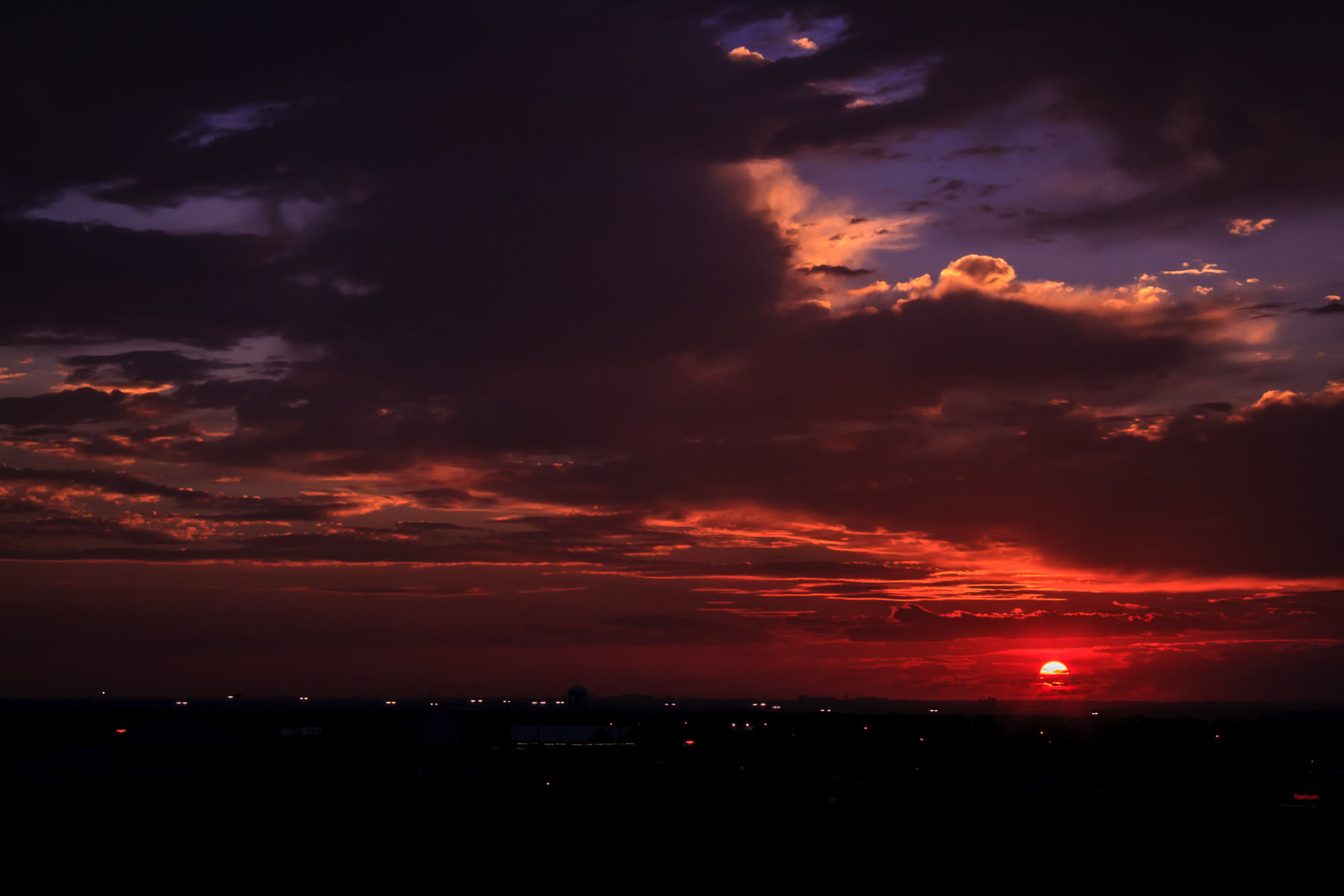 The sun setting over the western part of the Dallas-Fort Worth Metroplex.