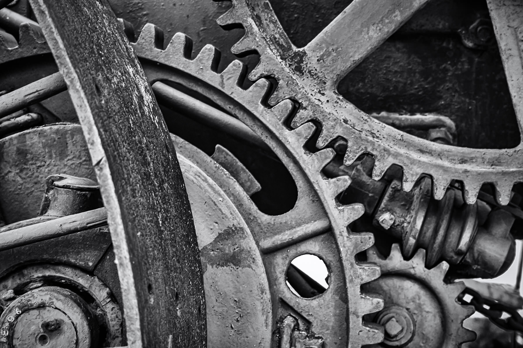 Detail of the drive train of an old steam-powered tractor in Marietta, Oklahoma.