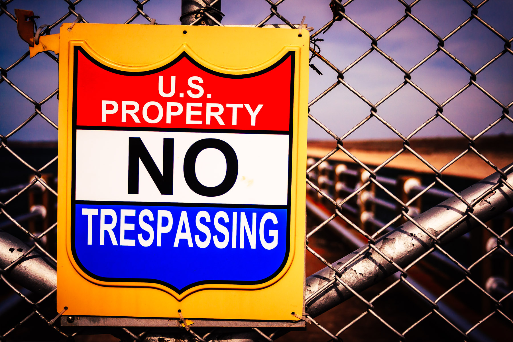 "A United State Government ""No Trespassing"" sign at Lake Texoma Dam on the Texas-Oklahoma border."