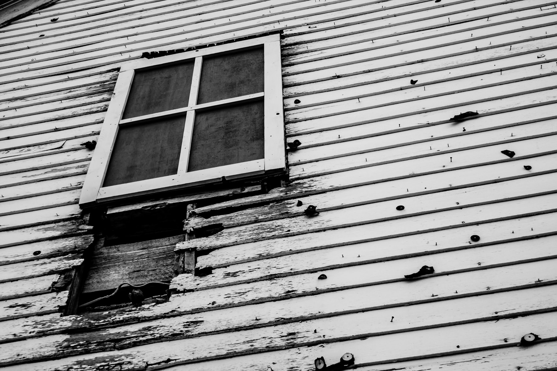 Decay marks a window at the Allen Heritage Village in Allen, Texas.
