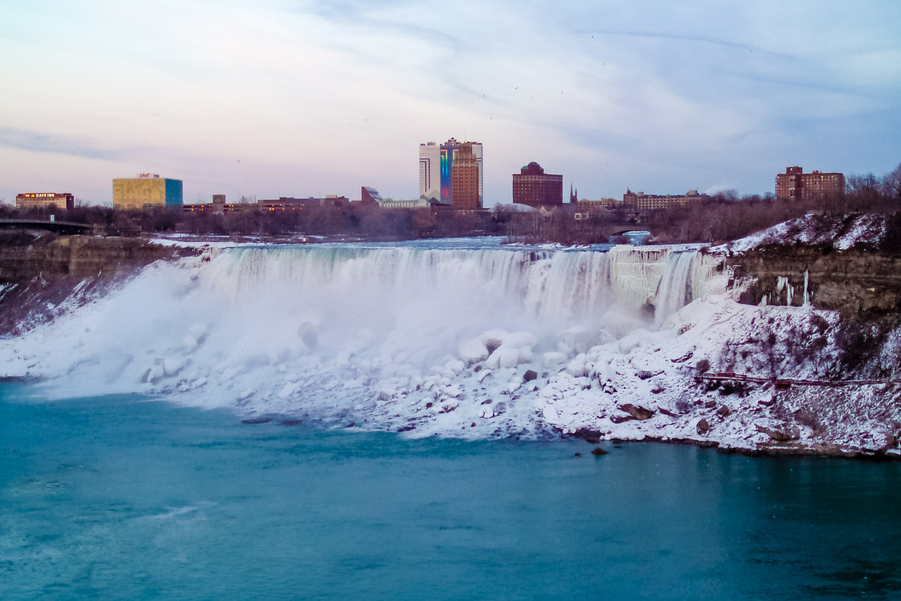 The American Falls at Niagara Falls as seen from the Canadian side of the border on a cold winter evening.