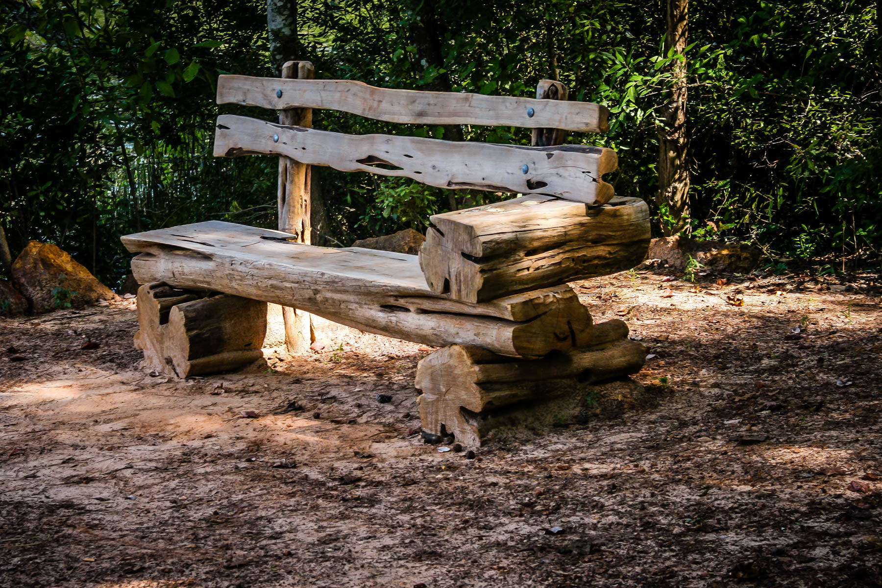 A rough-hewn log bench at Tyler State Park, Texas.