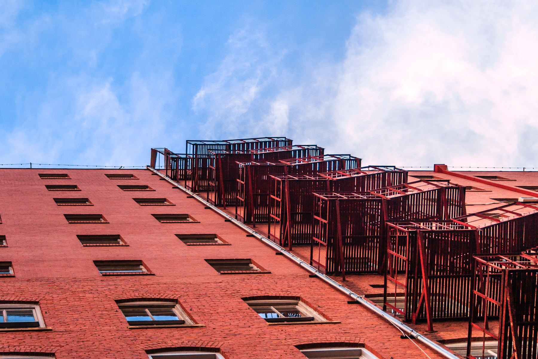 A fire escape climbs up the side of a building in Wichita Falls, Texas.