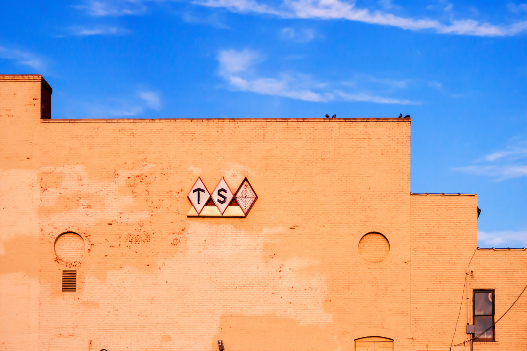 """A decaying Texas State Optical (missing the """"O"""") in Downtown Wichita Falls, Texas."""
