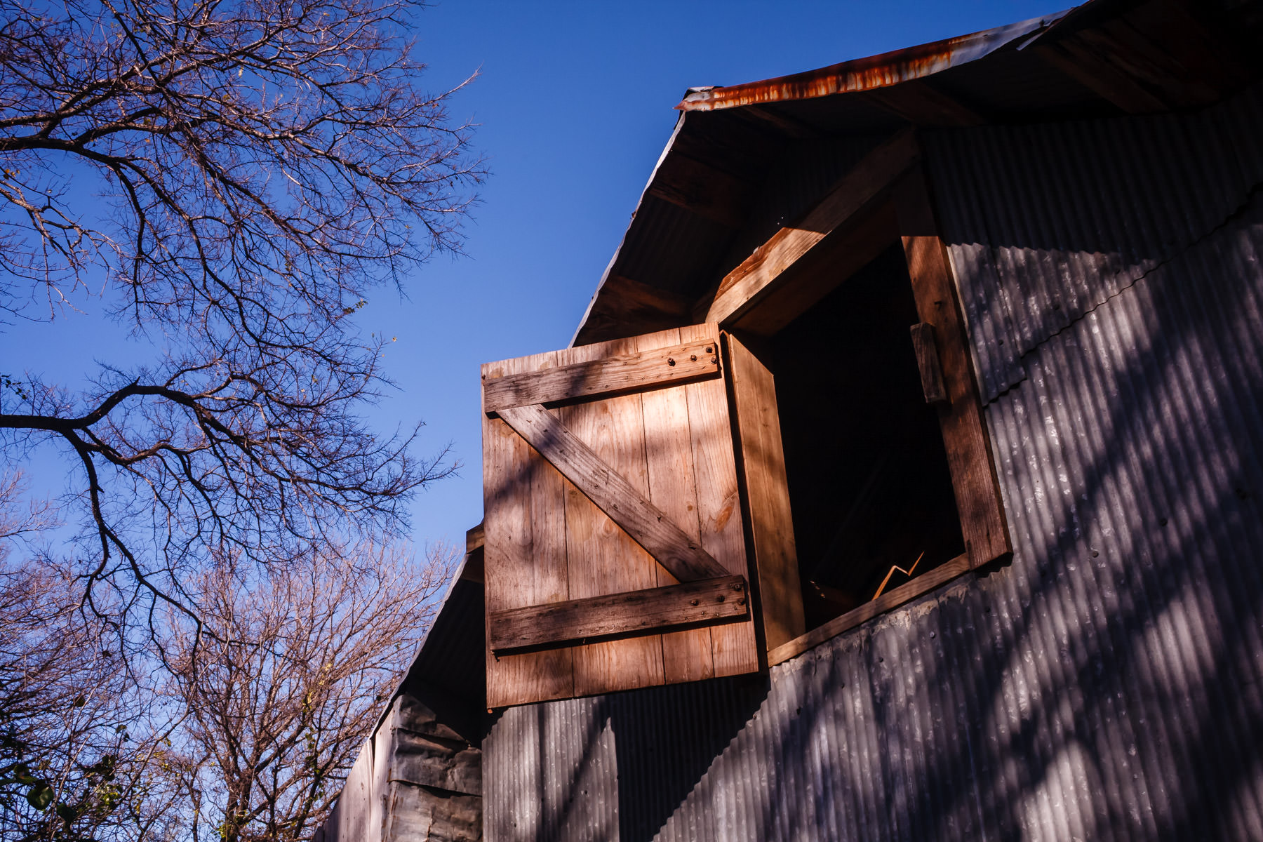 The hayloft door in an old barn at Cedar Hill State Park, Texas.