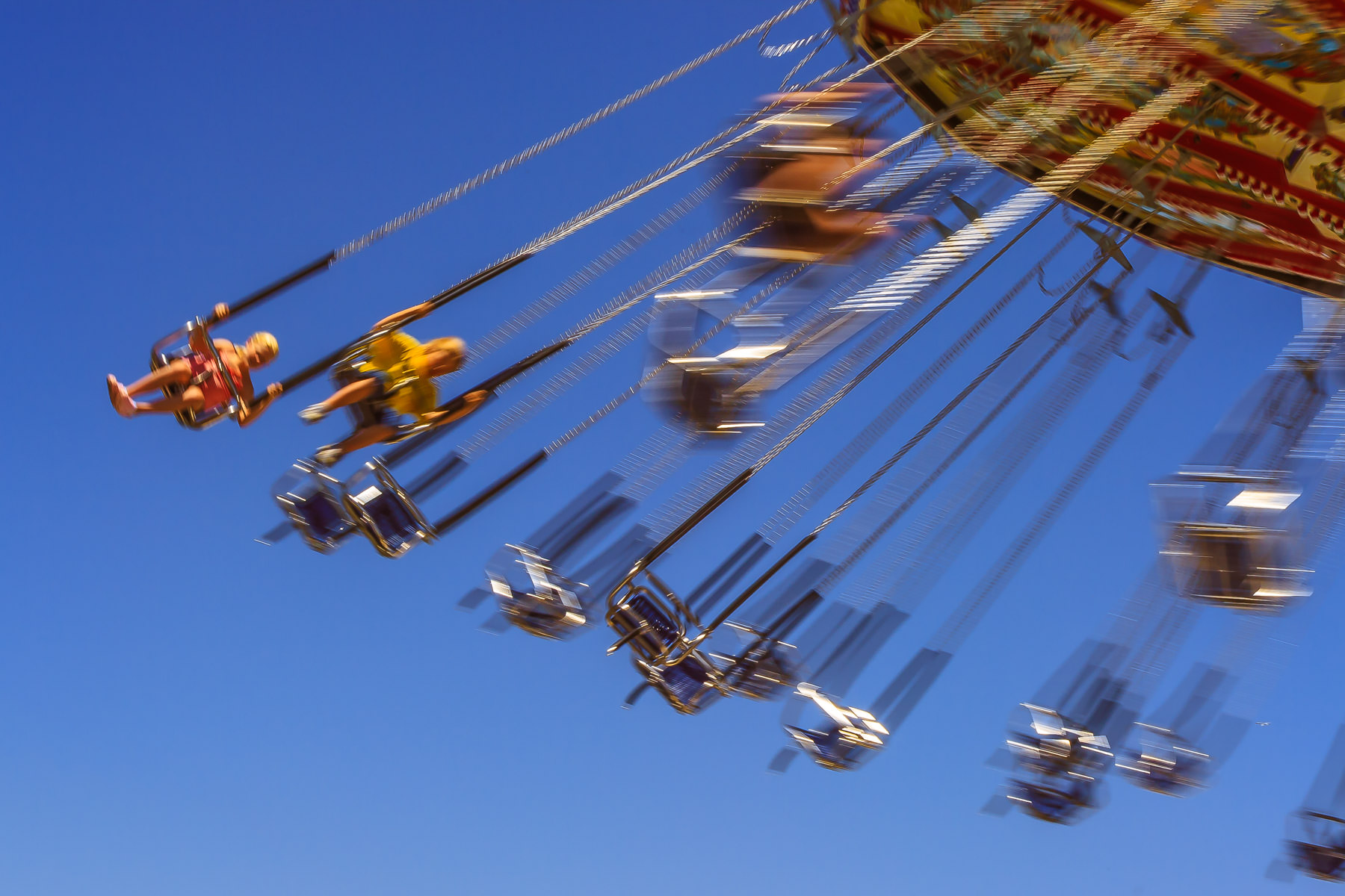 Swinging on a carnival ride in Grapevine, Texas' Main Street Days.