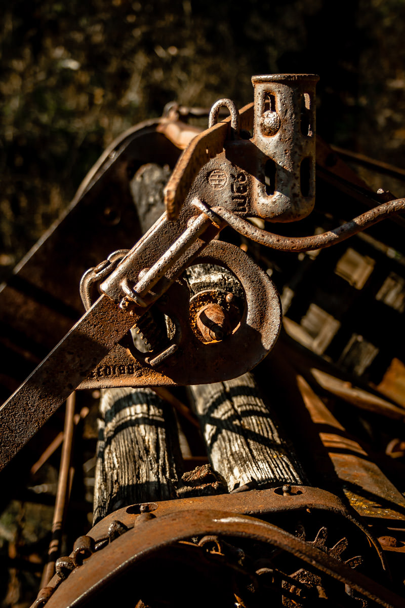 Old, decaying farm equipment at Penn Farm, Cedar Hill State Park, Texas.