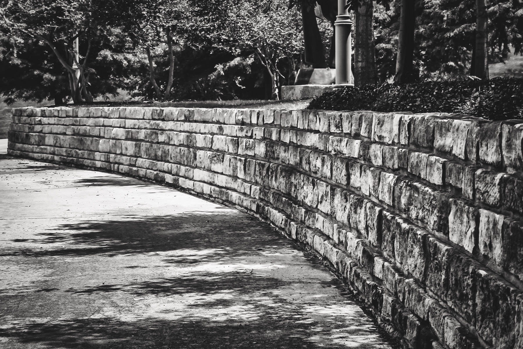 A rough-hewn stone wall at Hall Office Park in Frisco, Texas.