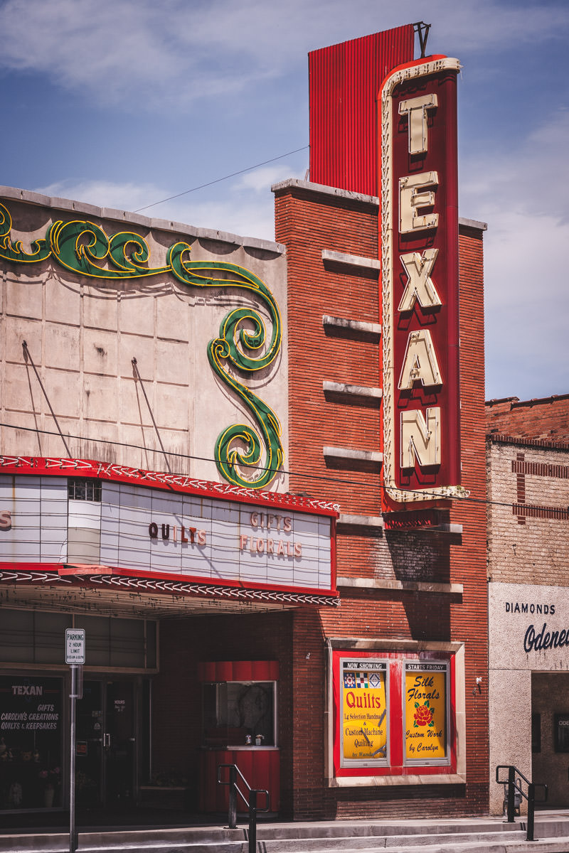The rundown facade of the Texan Theatre in Greenville, Texas.