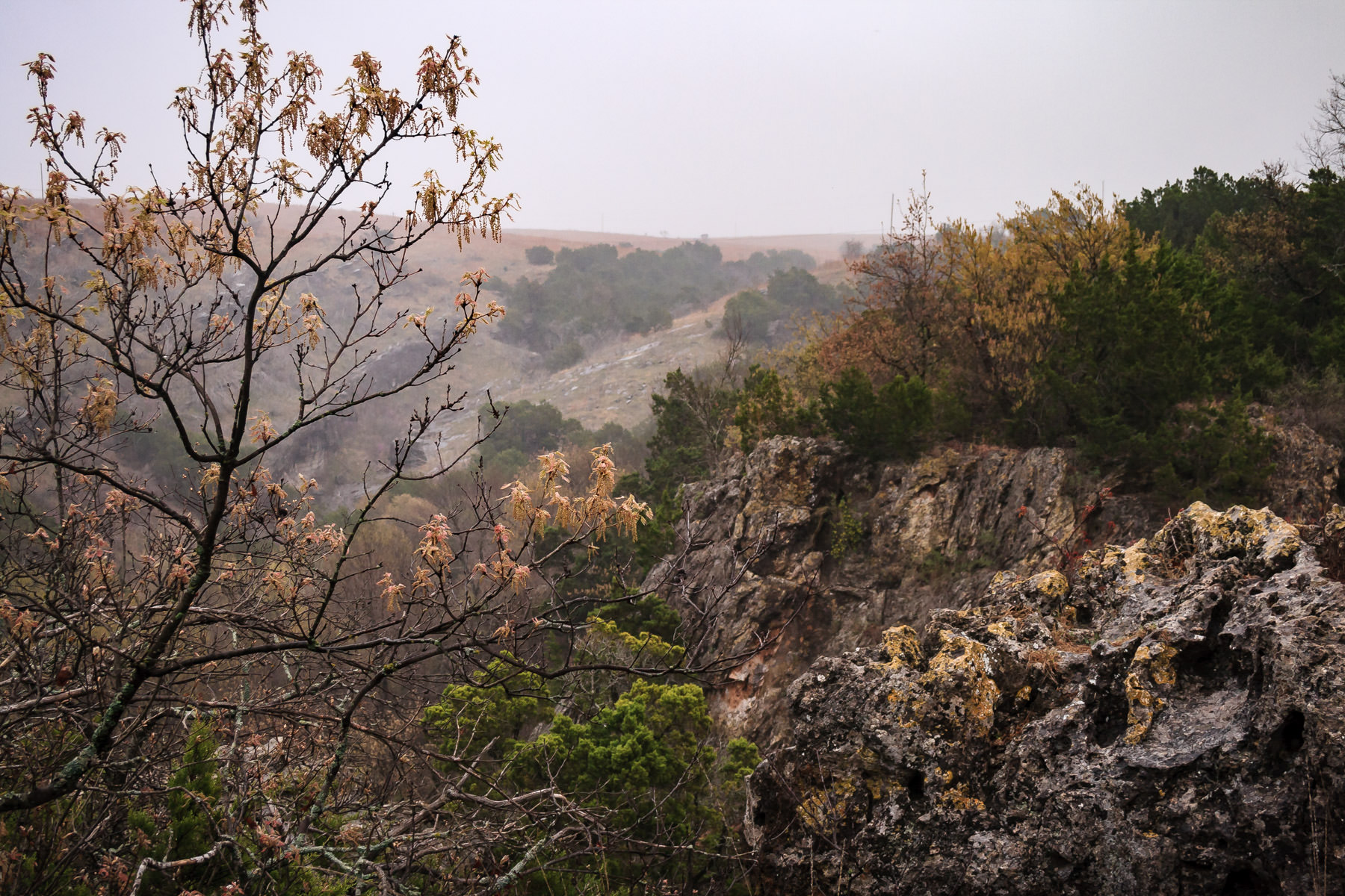 Fog roles into a valley at Turner Falls Park, Oklahoma.