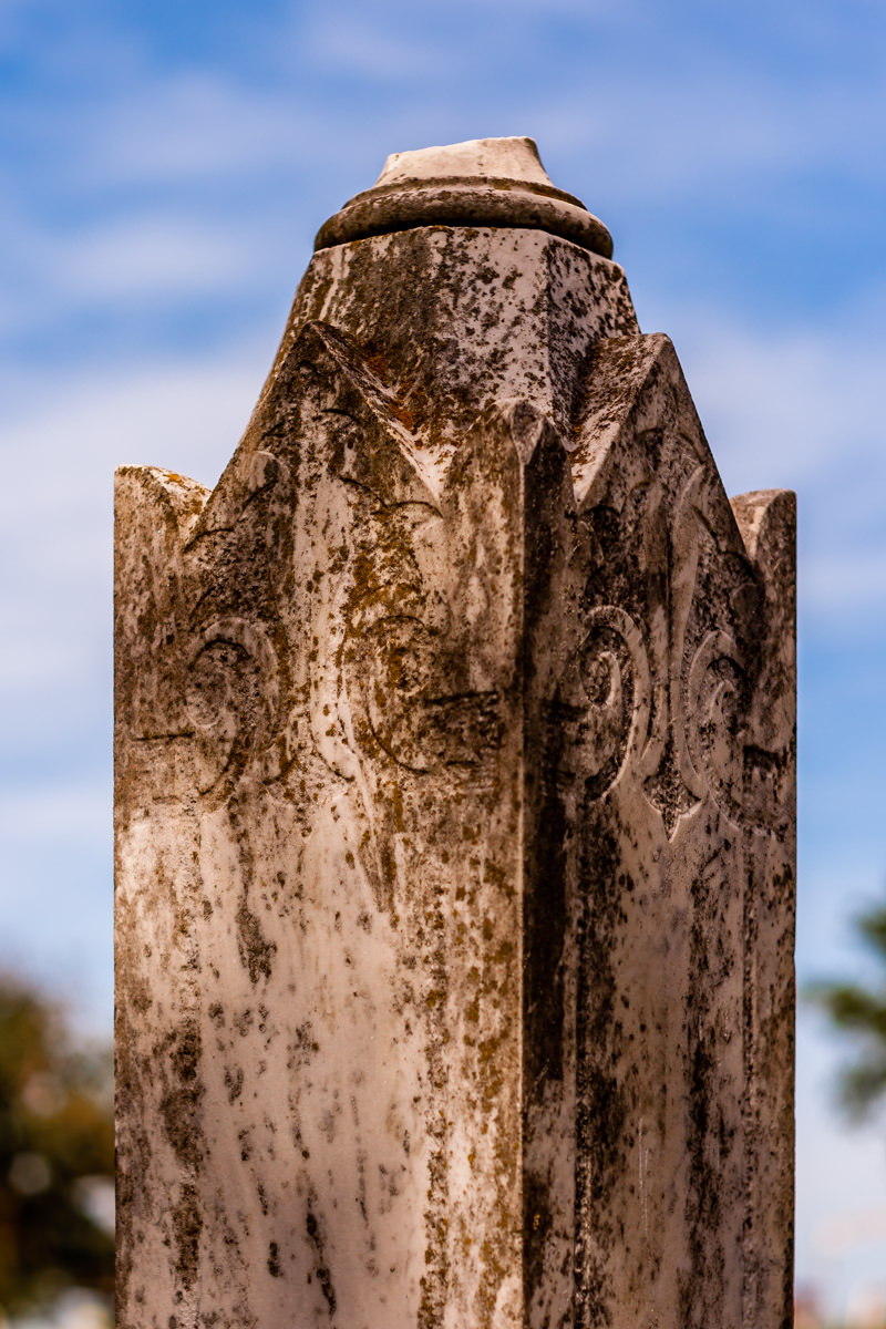 A carved stone decoration atop at headstone at Minters Chapel Cemetery on the grounds of DFW International Airport, Texas.