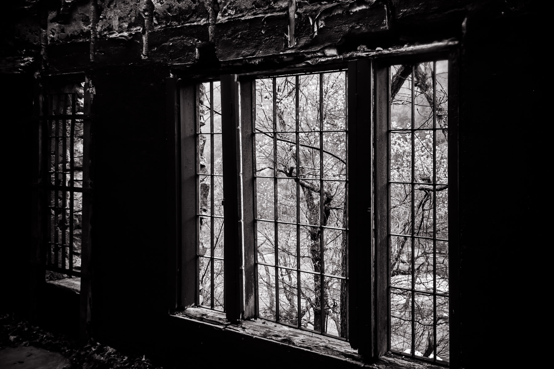 A window at an abandoned holiday cabin at Turner Falls Park, Oklahoma.