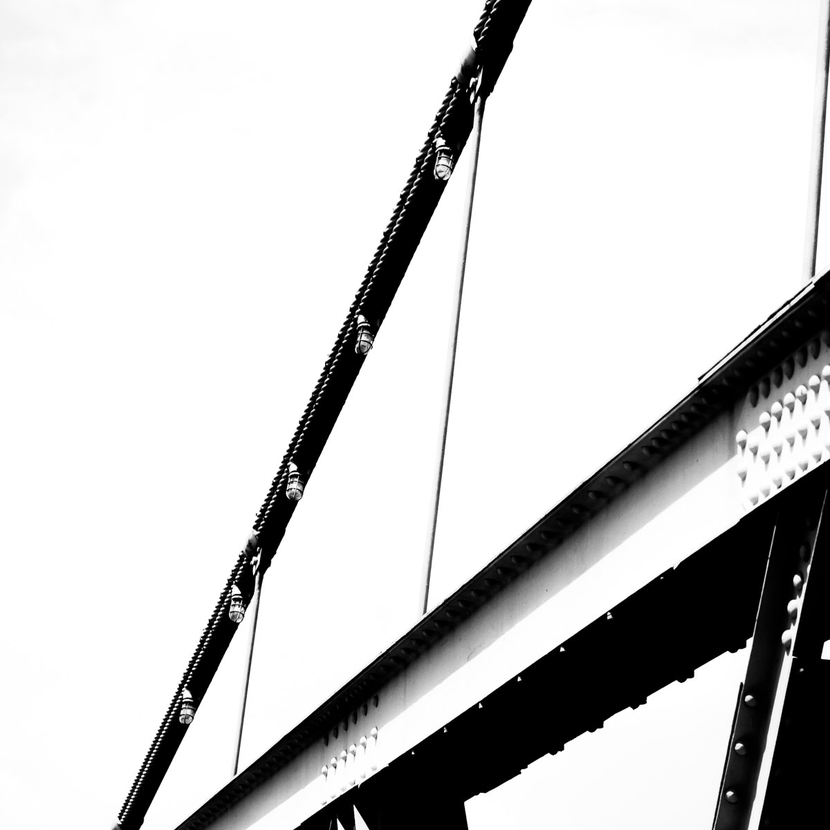 Support cables on the historic Waco Suspension Bridge over the Brazos River, Waco, Texas.