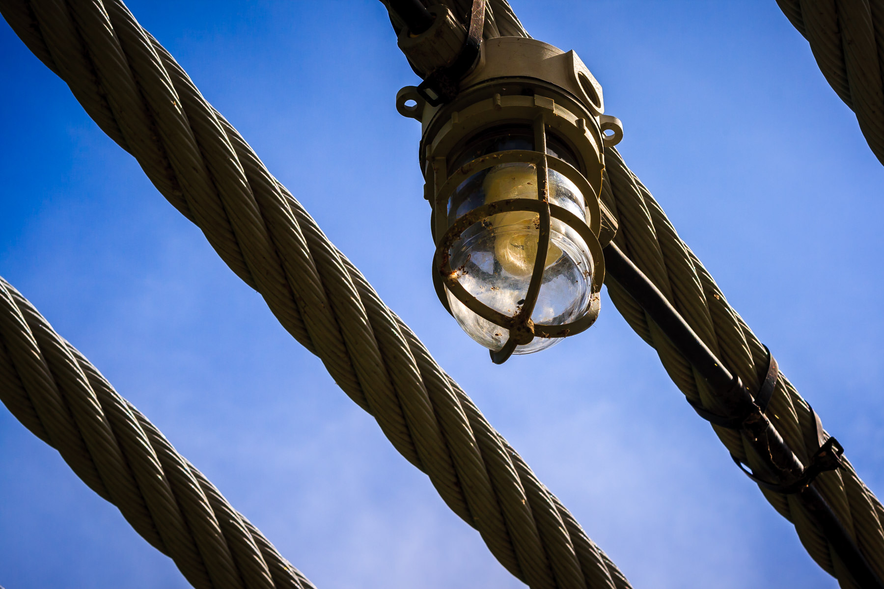 A light on a cable at the Waco Suspension Bridge, Waco, Texas.