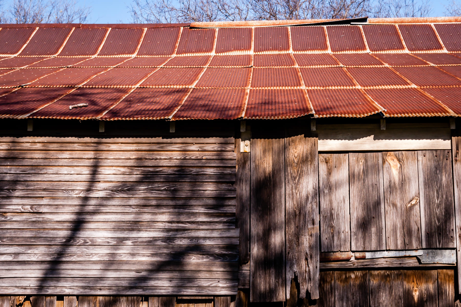 The side of a dilapidated barn at Penn Farm, Cedar Hill State Park, Texas.