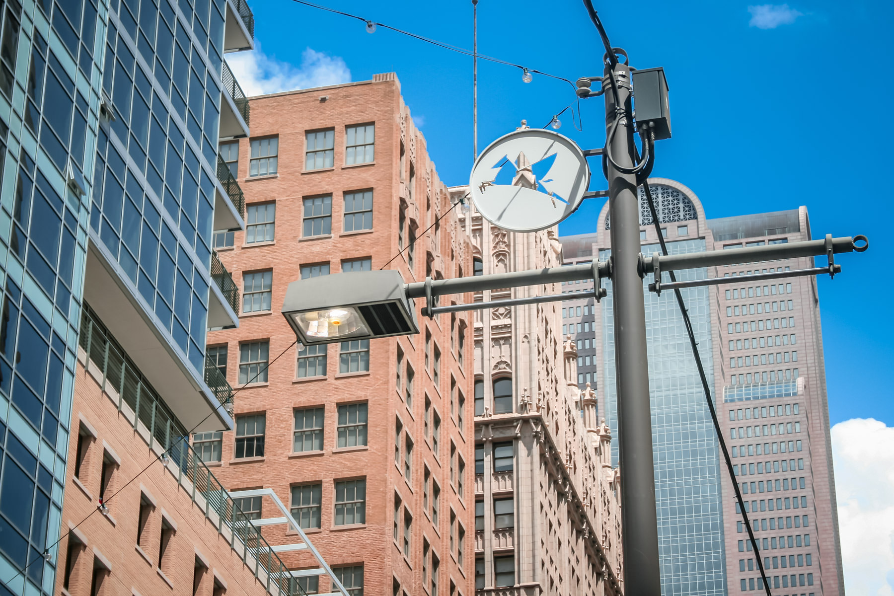 A cutout of a stylized Pegasus adorns this light pole in downtown Dallas.