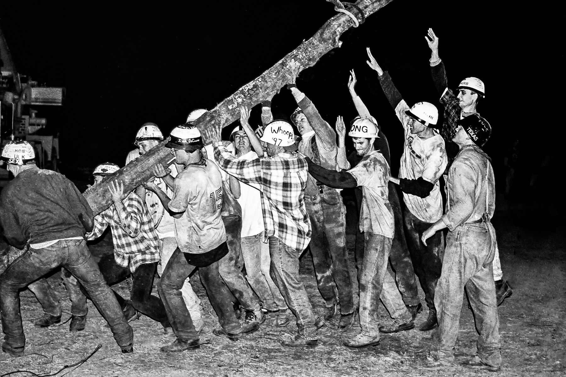 Students erect a log at 1997's Texas Aggie Bonfire, Texas A&M University, College Station.