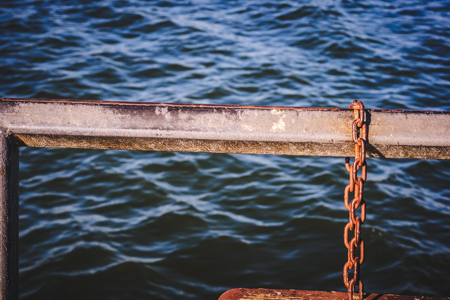 A railing and a chain on a pier at Lake Ray Roberts, Texas.