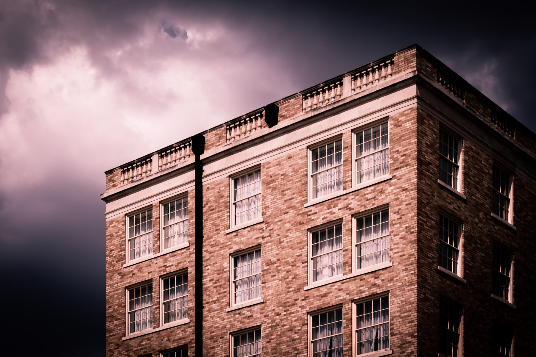Storm clouds brew over an old building in Downtown Bryan, Texas.