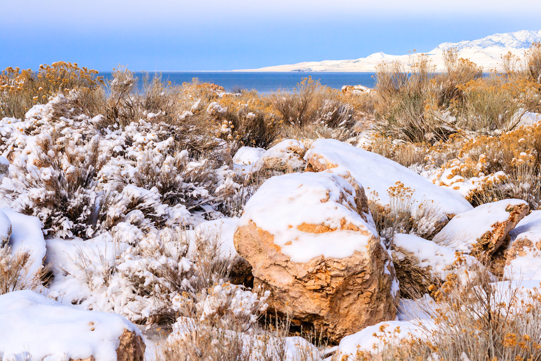 Snow-covered rocks at the desolate Antelope Island State Park, Utah.