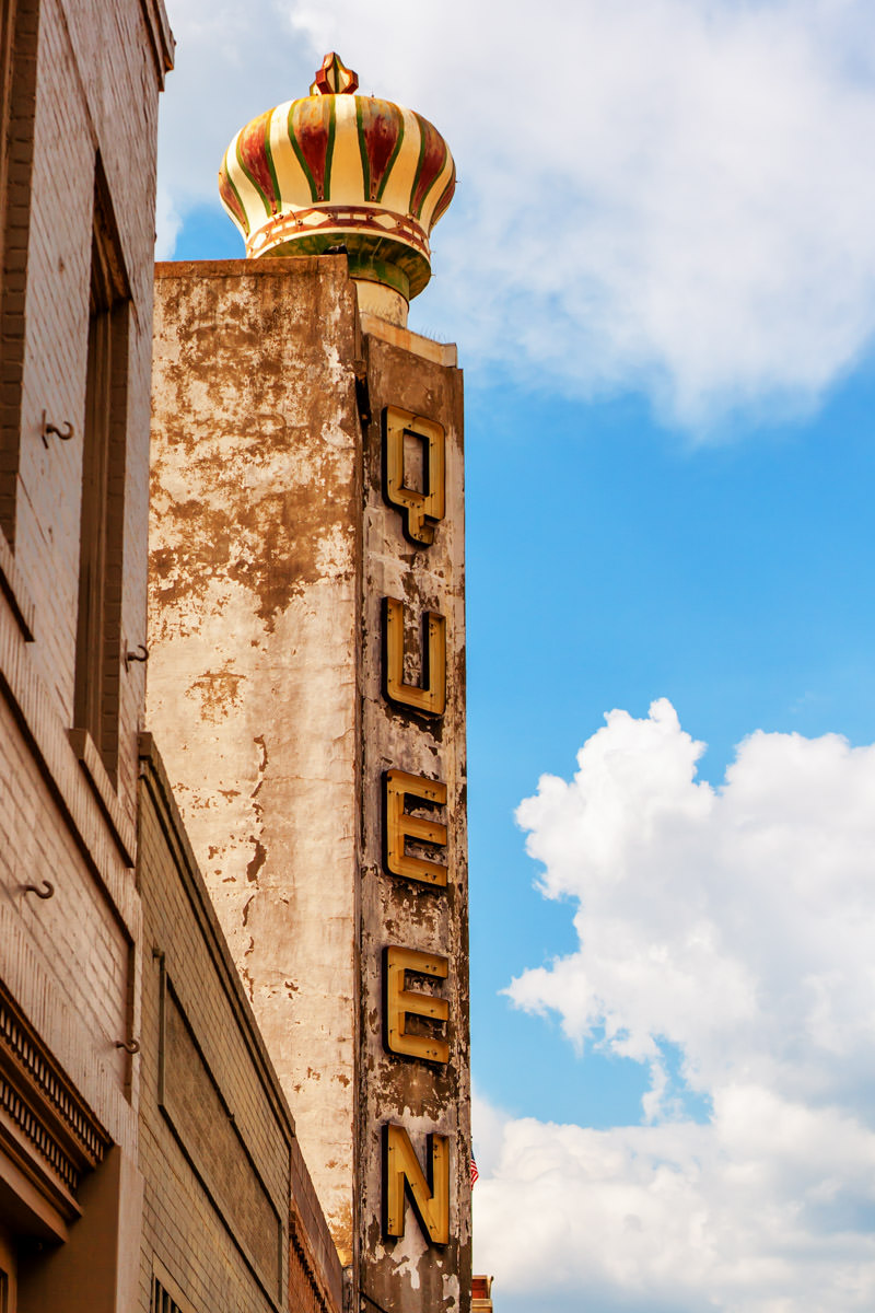 The sign of the decayed Queen Theatre in Downtown Bryan, Texas.