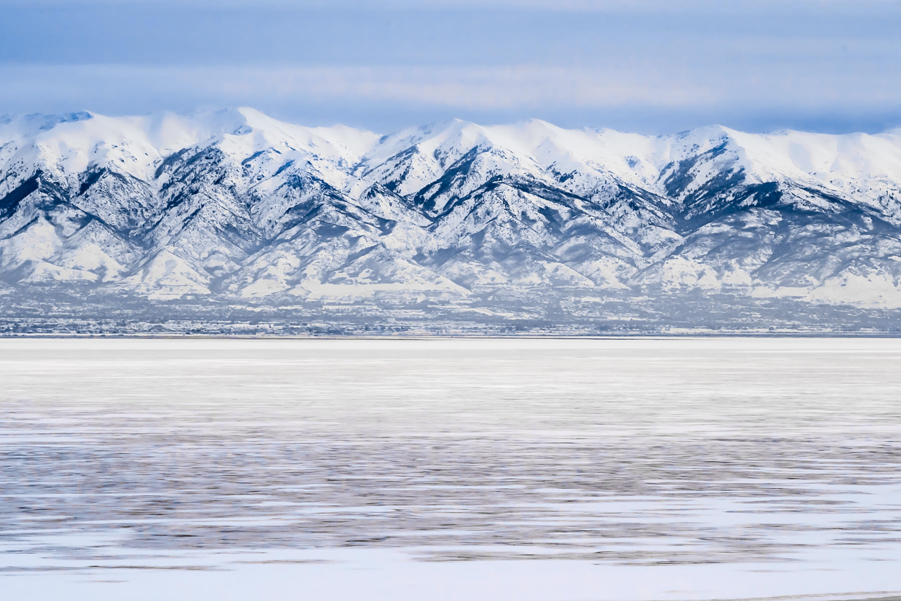 The Wasatch Front, shrouded in fog, as seen from Antelope State Park on the Great Salt Lake, Utah.