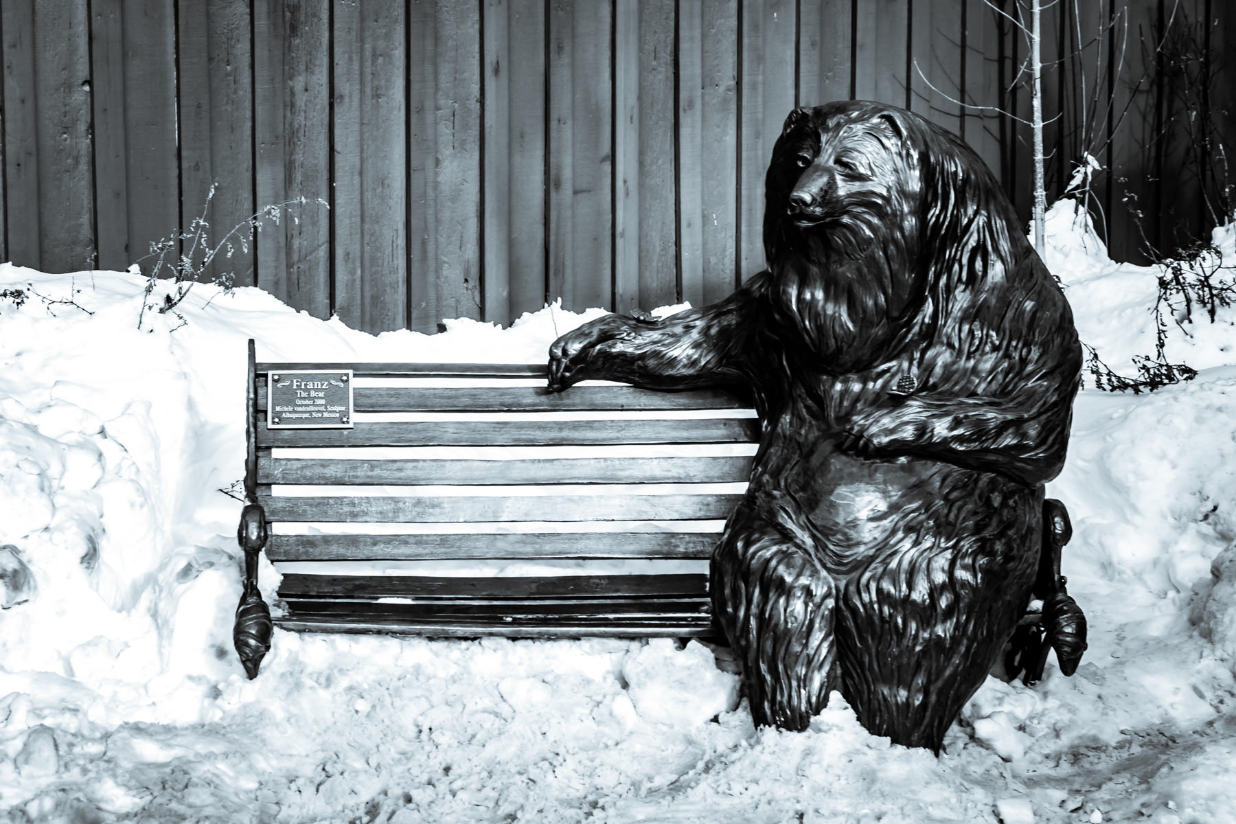 A bronze sculpture, Franz the Bear, by Michele Vandenheuvel, welcomes guests to sit next to him on a Park City, Utah, bench.
