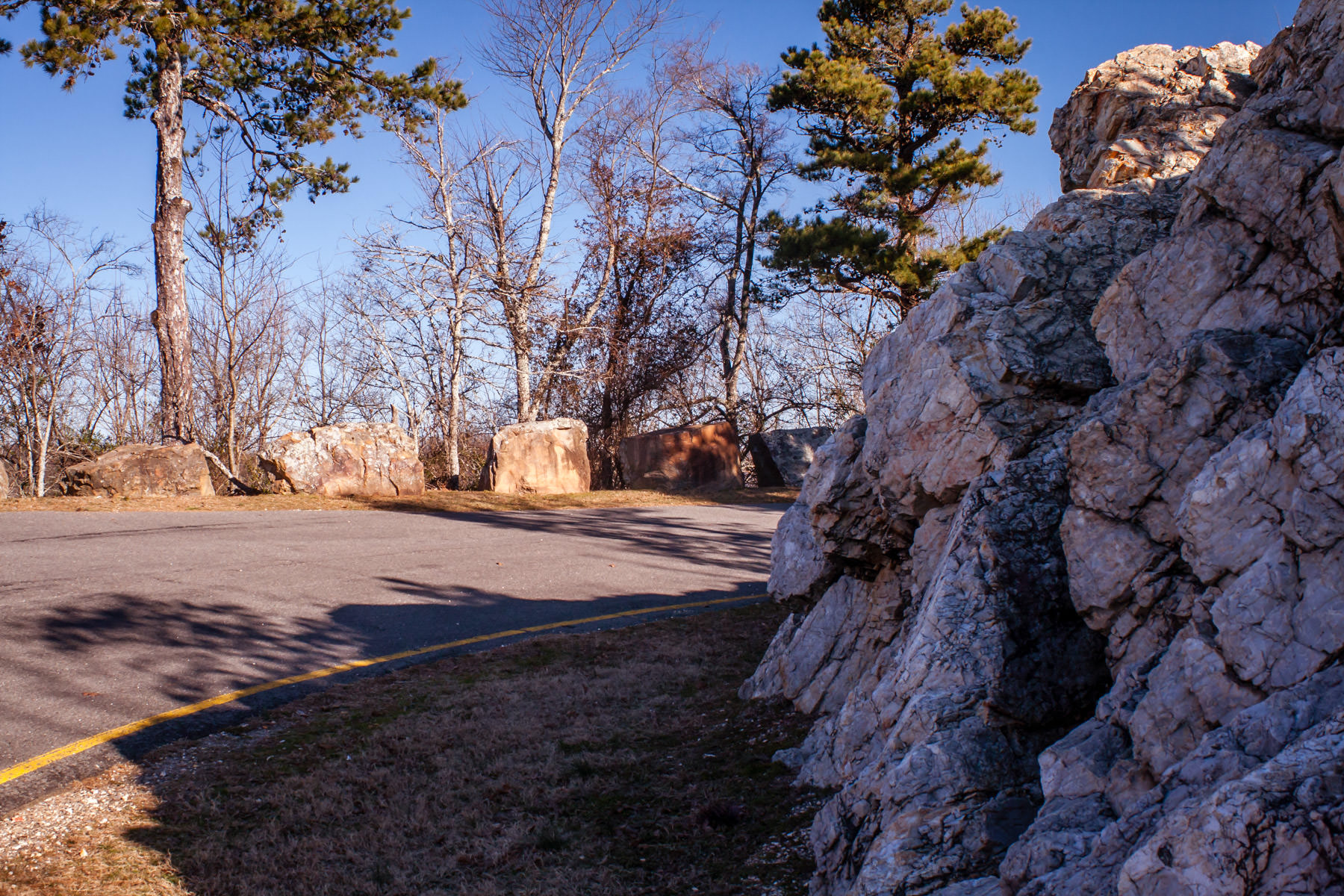 A road curves around rocks in the hills above Hot Springs, Arkansas.