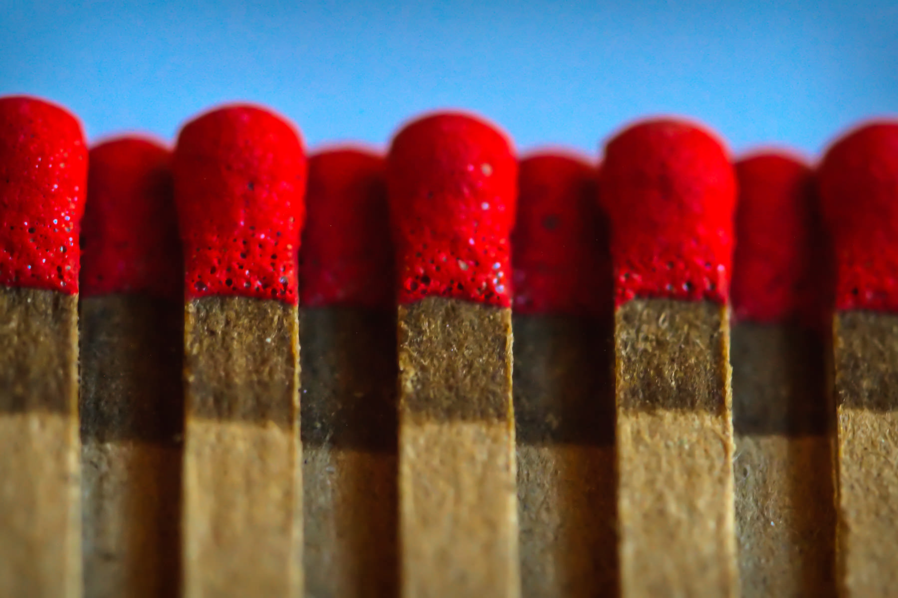 A macro photo of match heads.