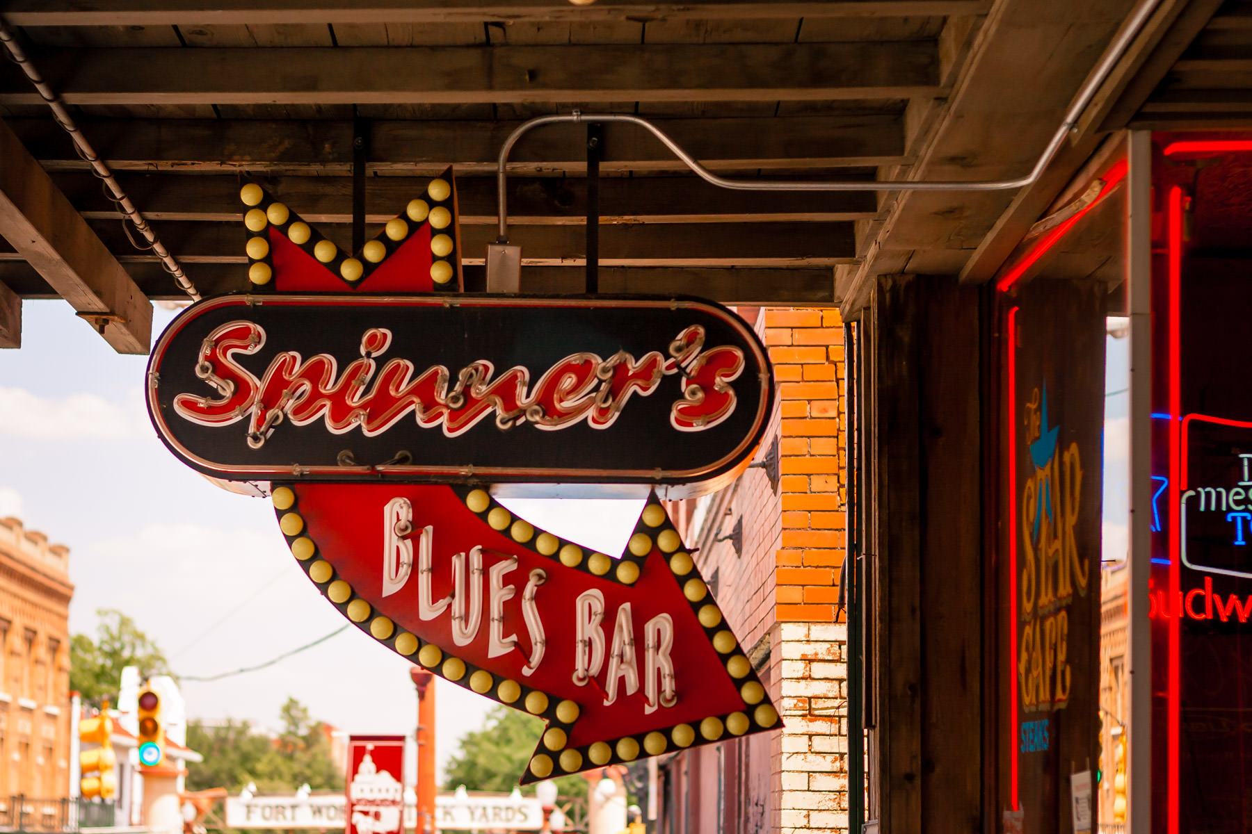 The neon sign of Spinner's Blues Bar in the historic Fort Worth Stockyards, Texas.