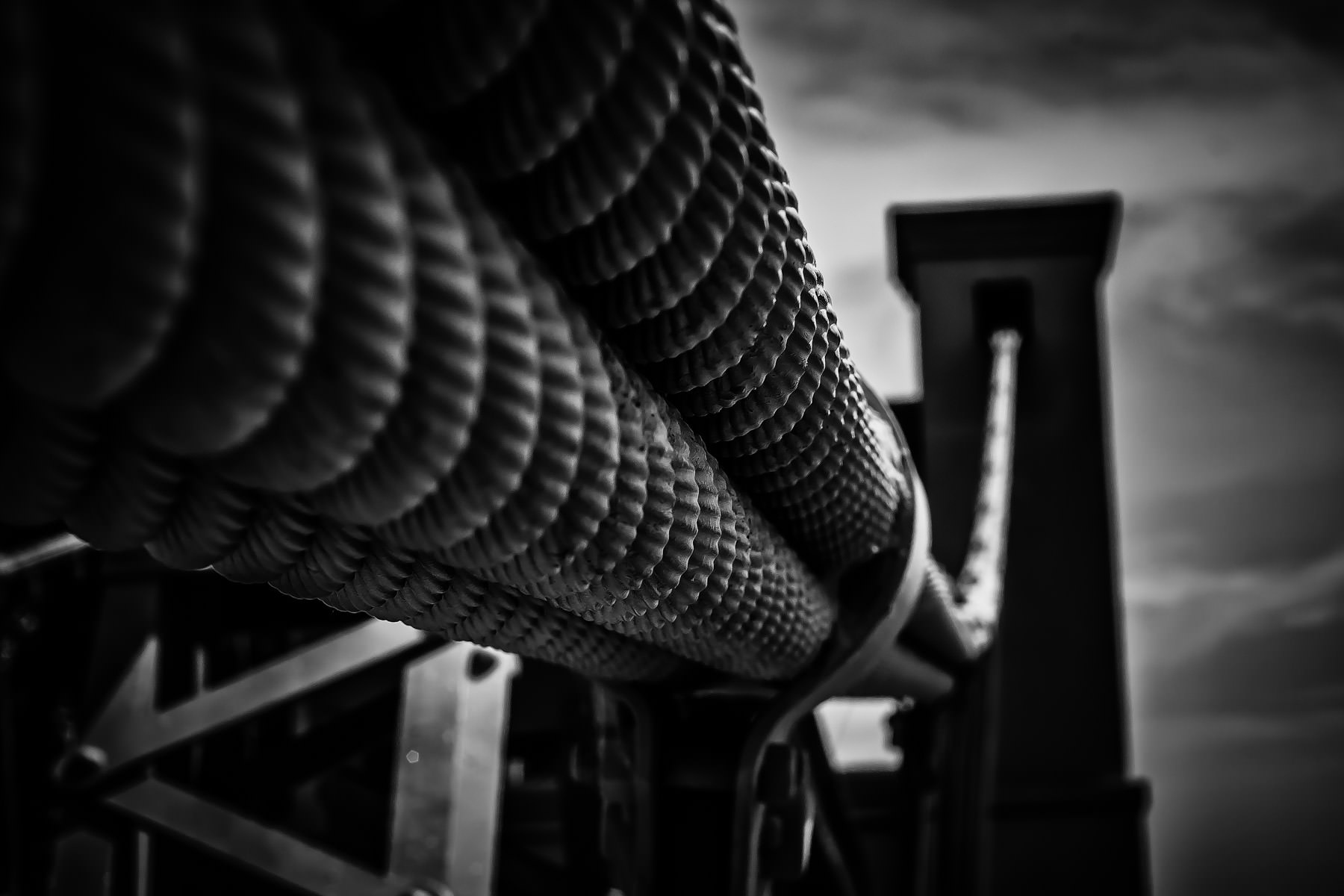 Support cables leading to the top of one of the support towers on the Waco Suspension Bridge, Waco, Texas.