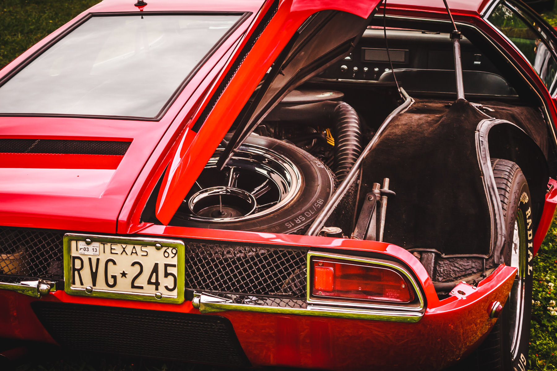 The right rear quarter of a DeTomaso Mangusta at Dallas' All British and European Car Day.