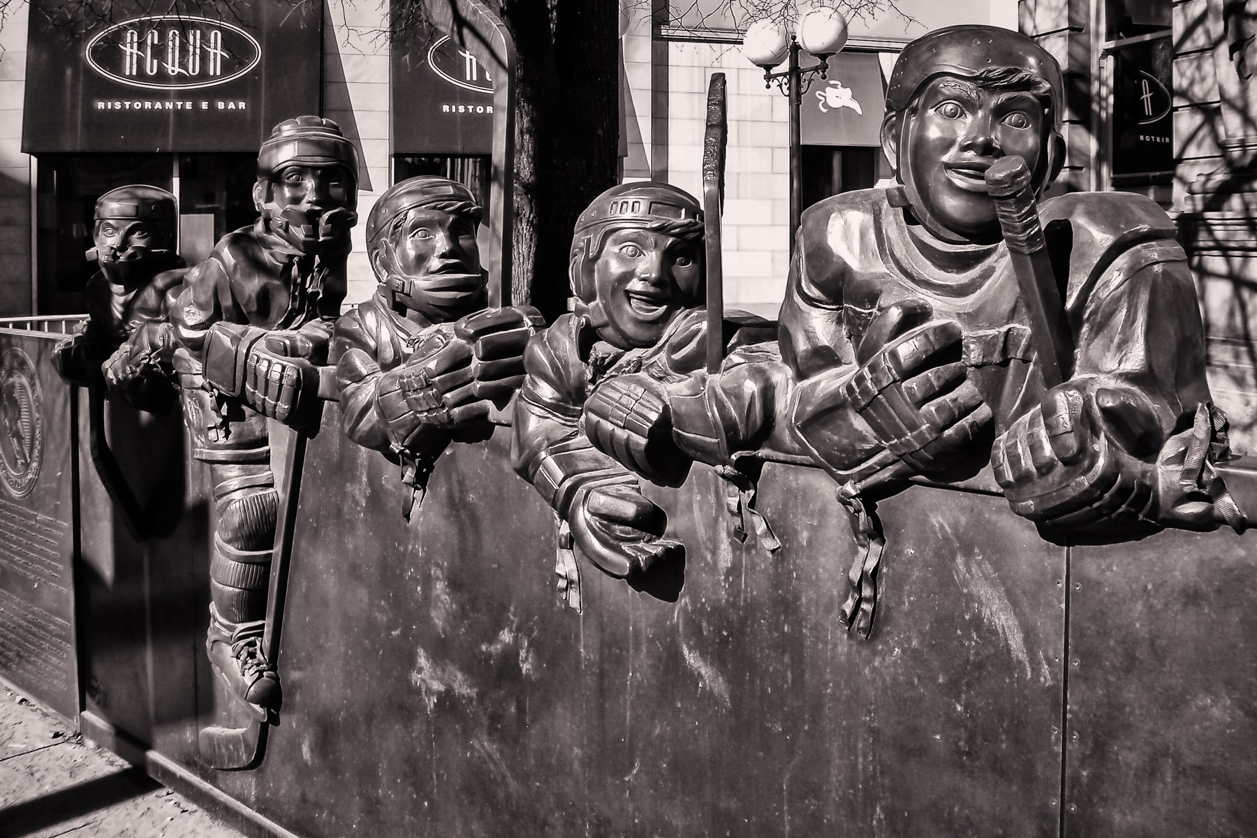 A bronze hockey sculpture outside of the Hockey Hall of Fame in Toronto.