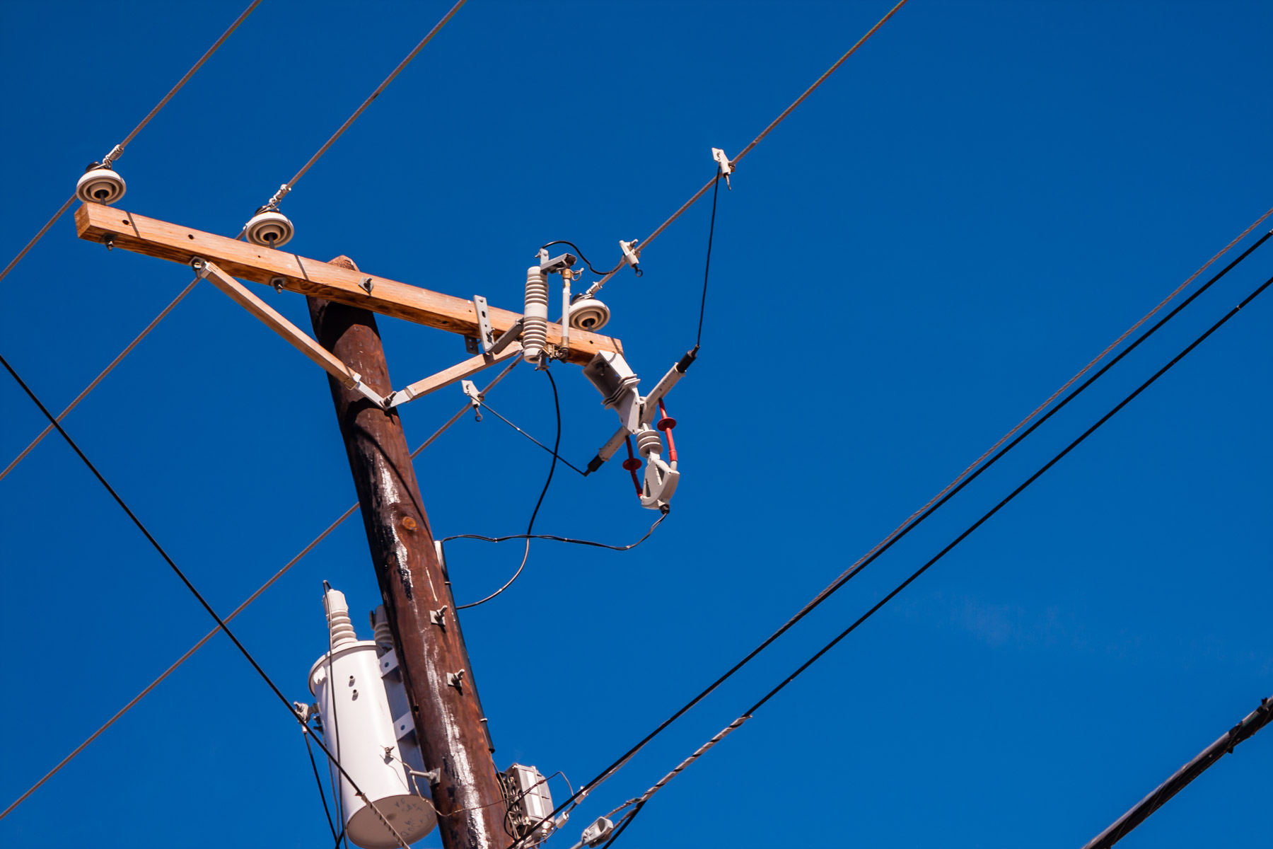Electric and telephone wires on a telephone pole in Dallas, Texas.
