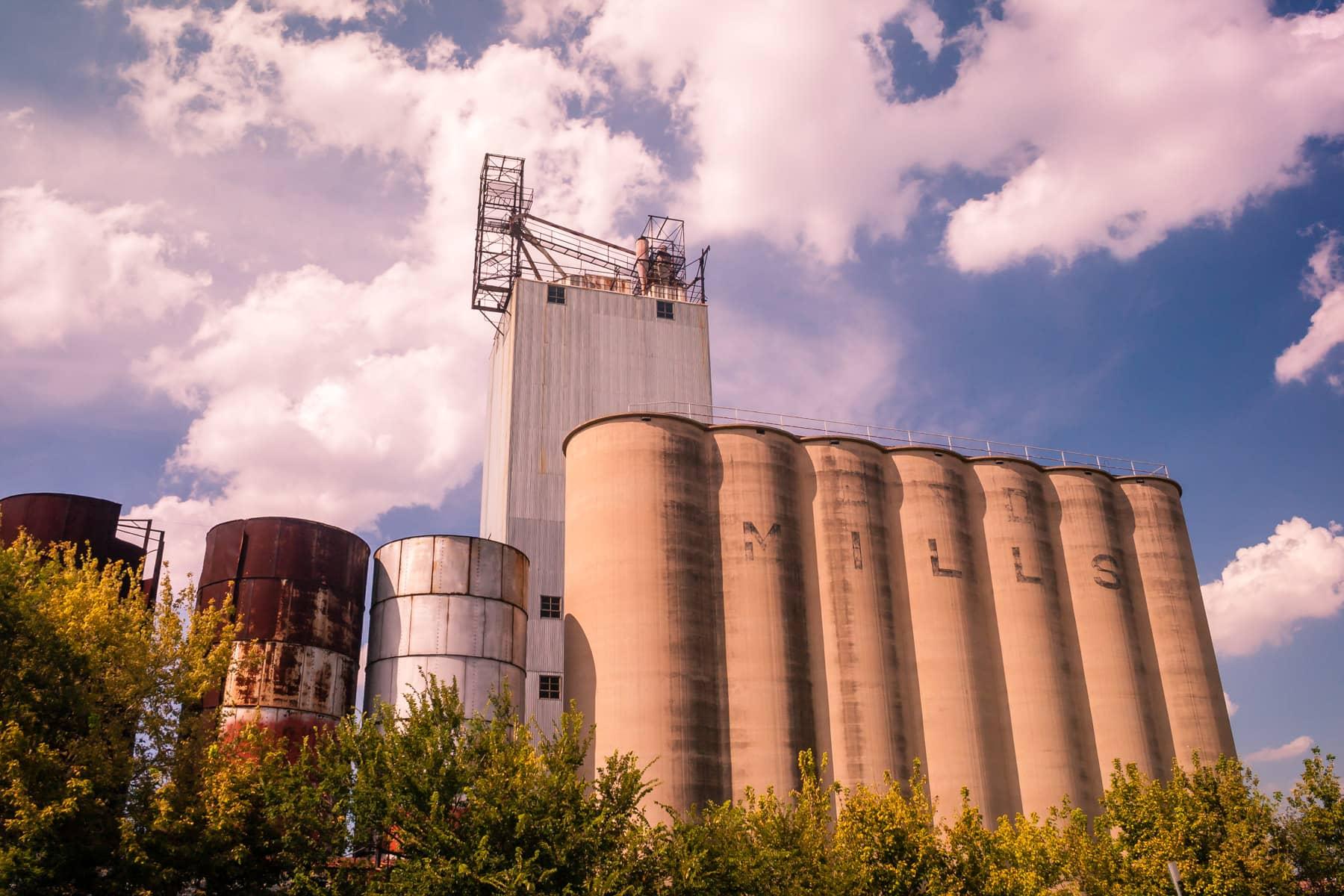 Grain silos rise into the cloudy sky in Grapevine, Texas.