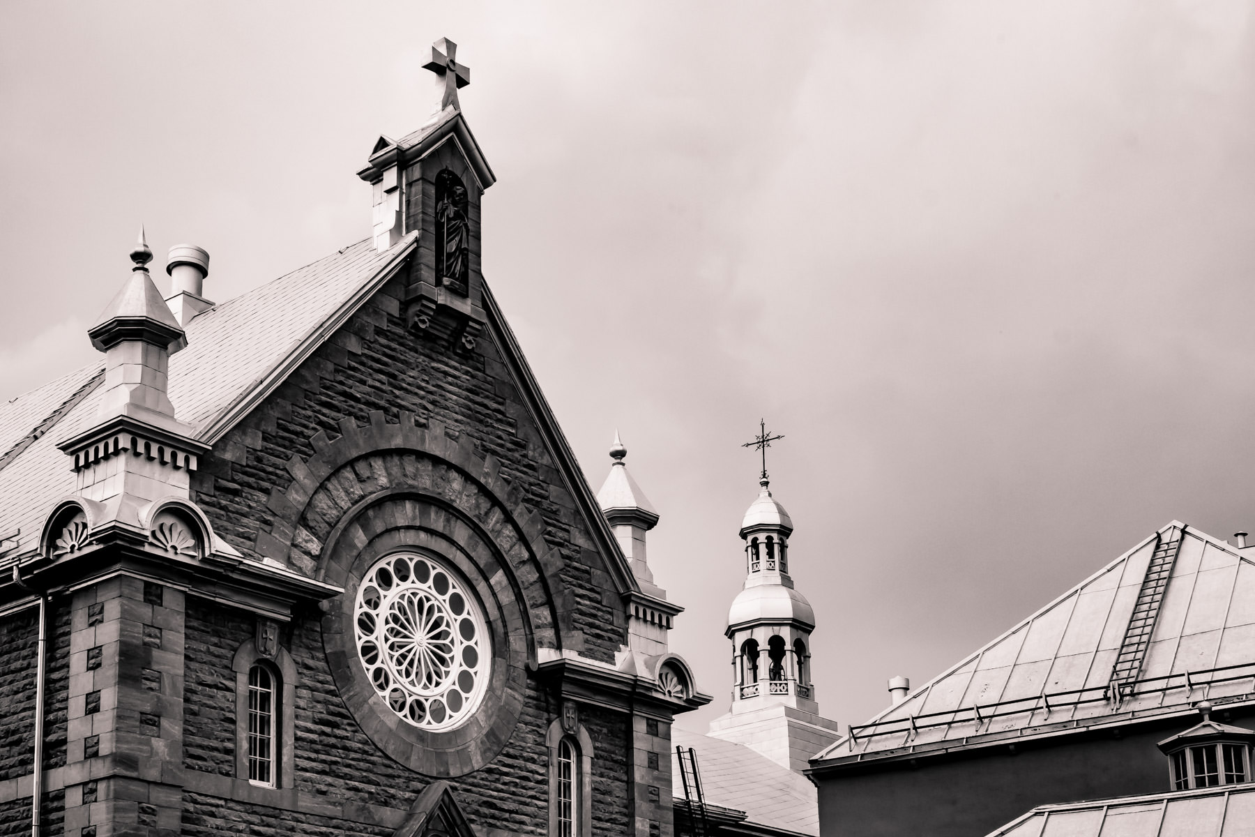 A church rises into the overcast sky in Québec City, Canada.