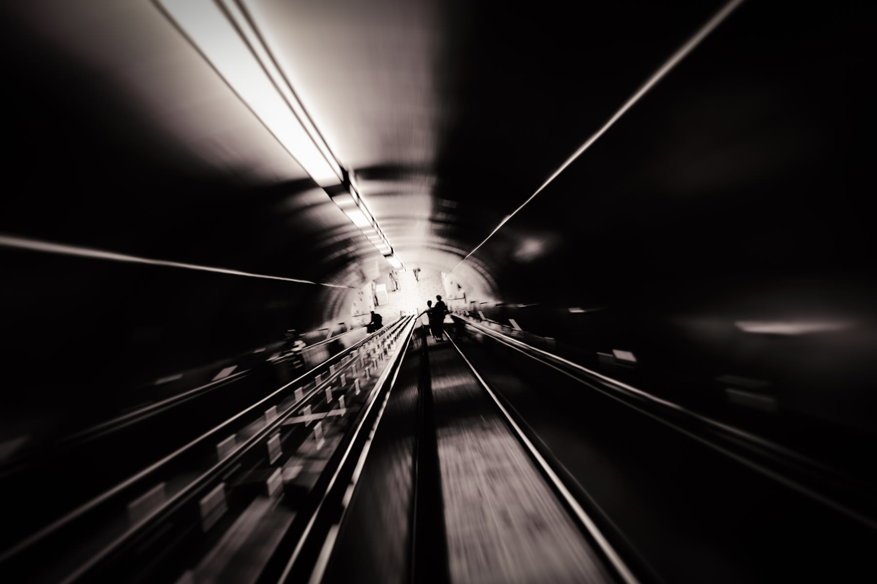 An inclined people mover leads to the bowels of Montréal's Beaudry metro station.