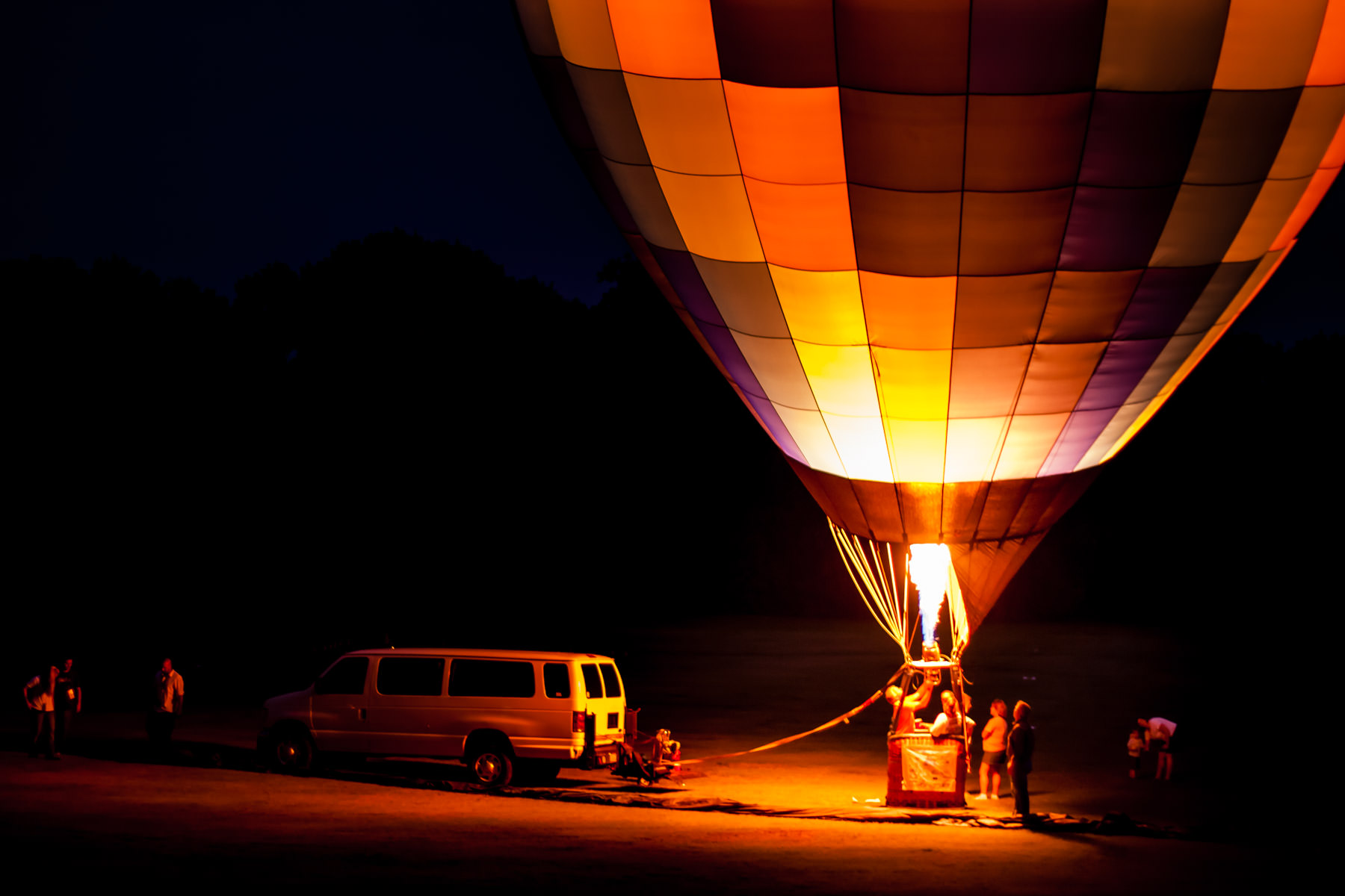 A balloon glows at the Plano Balloon Festival, Texas.