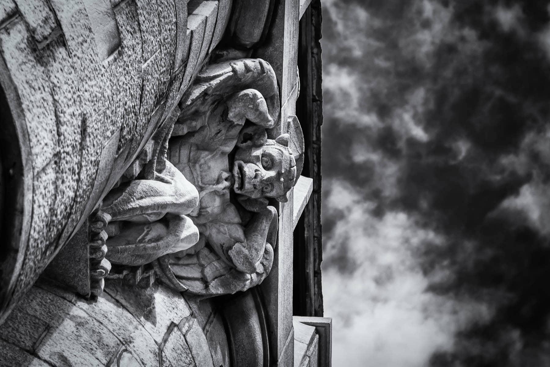 A gargoyle keeps watch over Montréal from La basilique Notre-Dame de Montréal.