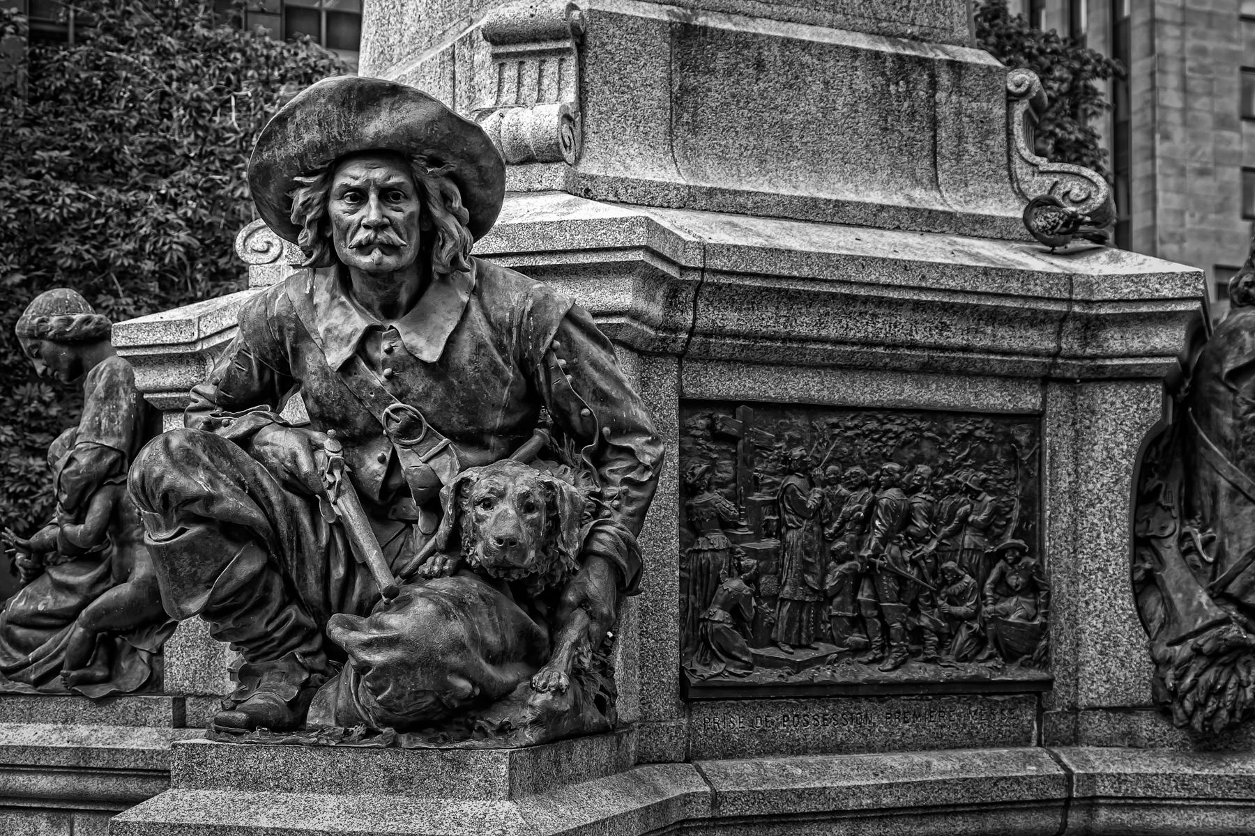 Detail from the base of the monument to Paul de Chomedey, defender of the city from the Iroquois, in Montréal's Place d'Armes.