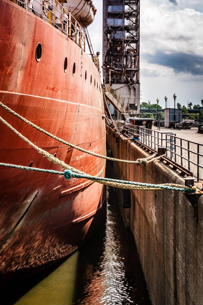 A decrepit ship docked along a quay in Vieux-Port de Montréal.