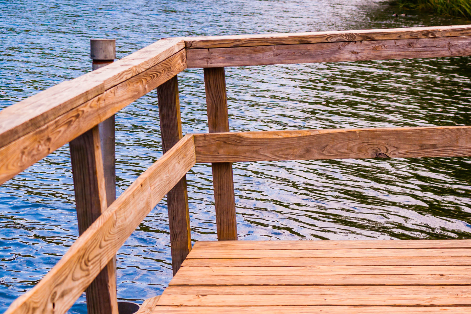 An off-kilter wooden pier at Tyler State Park, Texas.