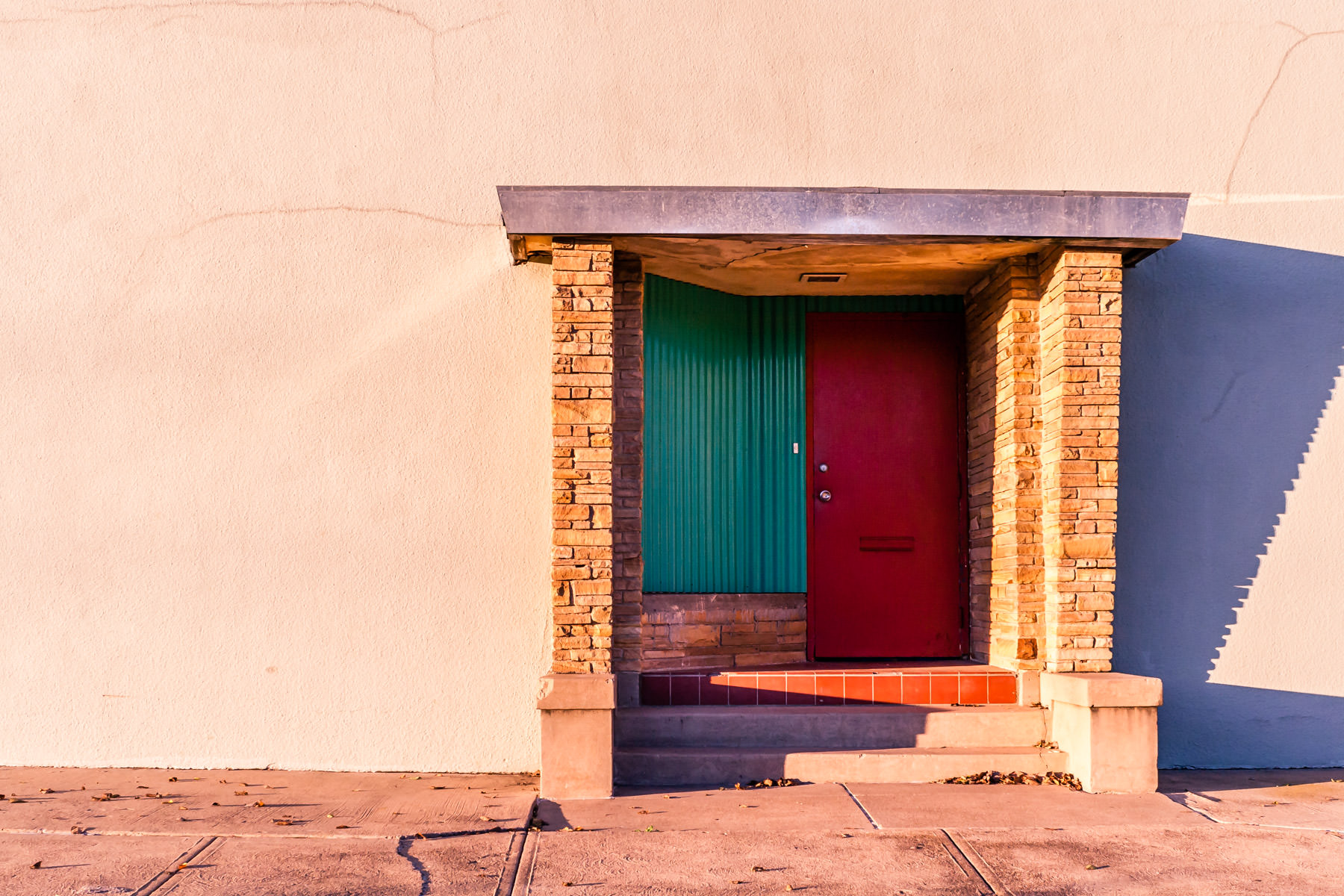 A door on the outside of a nondescript building in Dallas' Exposition Park/Fair Park neighborhood.