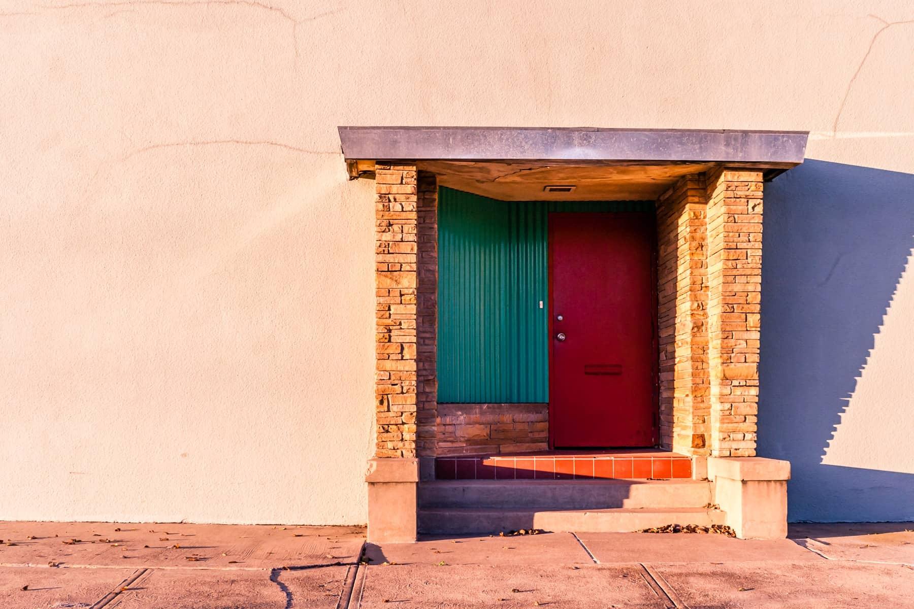 A door on the outside of a nondescript building in Dallas' Exposition Park/Fair Park neighborhood.