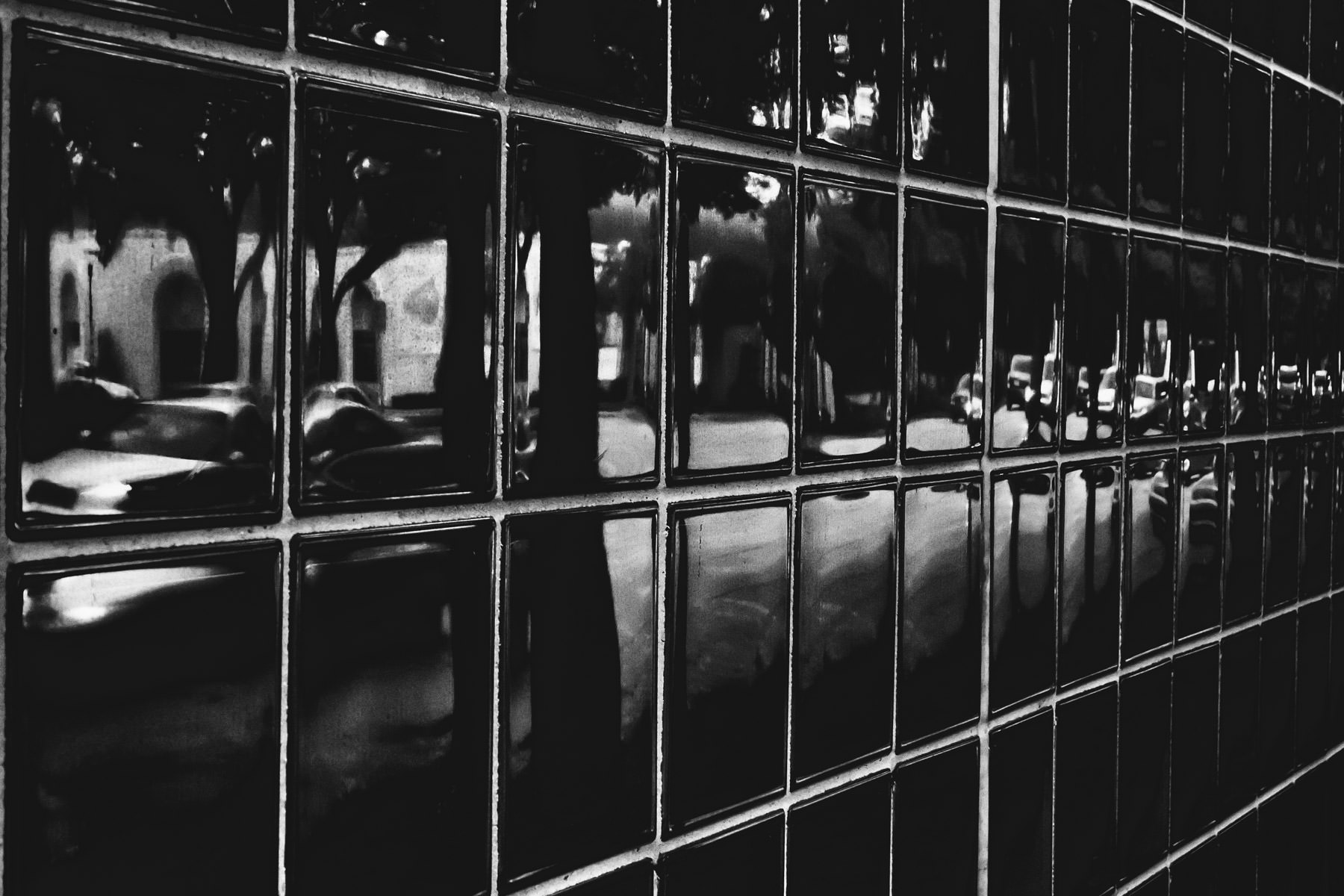 Bissonet Street reflected in the glass blocks of Houston's Contemporary Arts Museum.