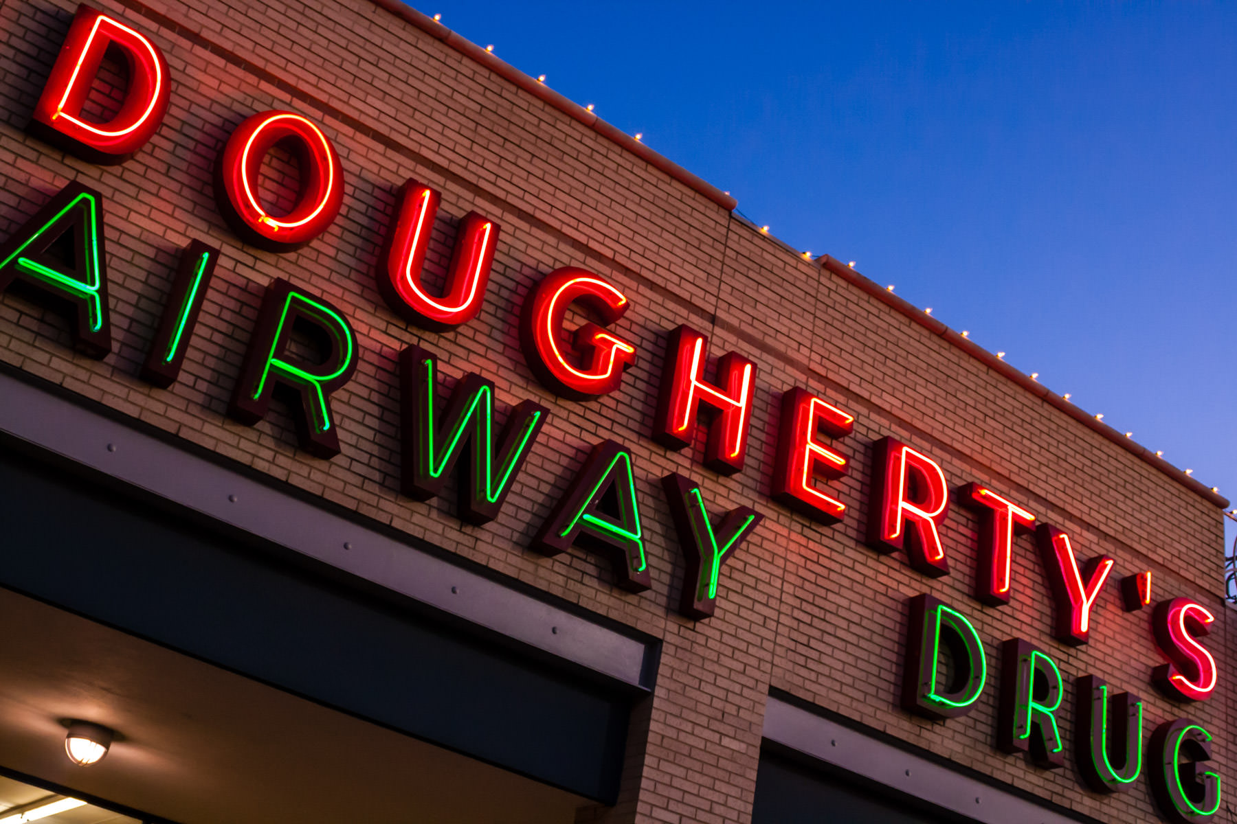 The neon sign of Dougherty's Airway Drug store in Dallas, Texas.