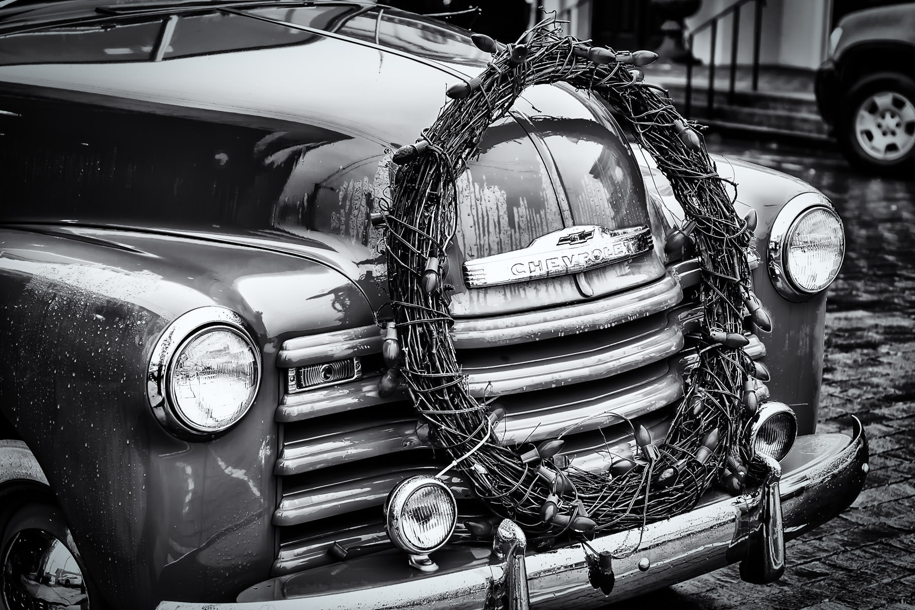 An old Chevrolet pickup truck decorated with a Christmas wreath in Jefferson, Texas.